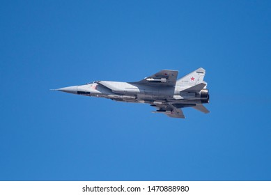 Novosibirsk, Russia - April 1, 2019: Mikoyan-Gurevich MiG-31BM Foxhound RF-92337 in the sky after take off from the international airport Tolmachevo.