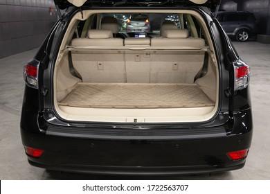 Novosibirsk/ Russia – April 22 2020:  Lexus RX350 ,close-up of the open trunk, headlight, bumper,  front view. Exterior of a modern car