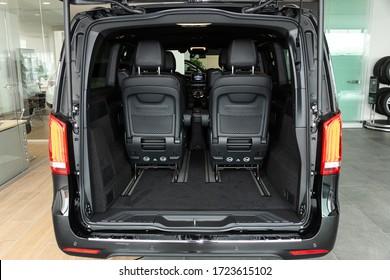 Novosibirsk/ Russia – April 28 2020:  Mercedes-Benz V-class, close-up of the open trunk, headlight, bumper,  front view in minivan. Exterior of a modern car