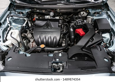 Novosibirsk, Russia – August 01, 2019:   Mitsubishi Lancer, close-up of the engine, front view. Internal combustion engine, car parts, deteyling