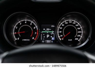 Novosibirsk, Russia – August 01, 2019:   Mitsubishi Lancer, Car dashboard with white  backlight: Odometer, speedometer, tachometer, fuel level, water temperature and more