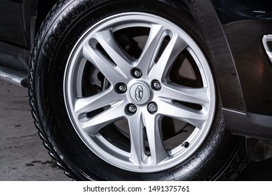 Novosibirsk, Russia – August 01, 2019:  Hyundai Santa Fe, close-up of the bumper, alloy wheel, car detailing  with sport breaks