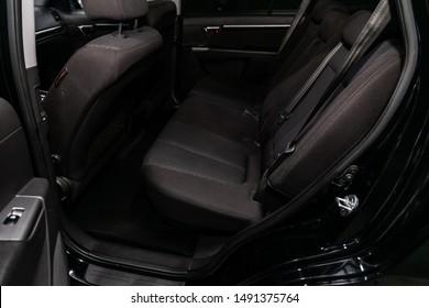 Novosibirsk, Russia – August 01, 2019:  Hyundai Santa Fe, black interior design, car passenger and driver seats with seats belt.