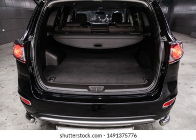 Novosibirsk, Russia – August 01, 2019:  Hyundai Santa Fe, close-up of the open trunk, headlight, bumper,  front view. Photography of a modern car on a parking in Novosibirsk