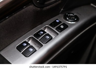 Novosibirsk, Russia – August 01, 2019:  Hyundai Santa Fe, close-up of the side door buttons: window adjustment buttons, door lock. modern car interior: parts, buttons, knobs
