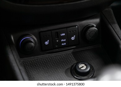 Novosibirsk, Russia – August 01, 2019:  Hyundai Santa Fe, close-up of seat heating buttons, charging in the car, cigarette lighter, aux, usb connectors. modern car interior: parts, buttons, knobs