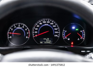 Novosibirsk, Russia – August 01, 2019:  Hyundai Santa Fe, close-up of round dashboard, speedometer and tachometer with white backlight. modern car interior