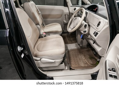 Novosibirsk, Russia – August 01, 2019:  Toyota Porte, Black luxury car Interior - steering wheel, shift lever, multimedia  systeme, driver seats and dashboard