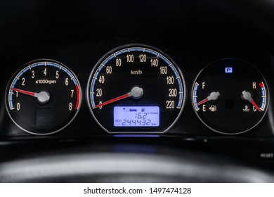 Novosibirsk, Russia – August 19, 2019: Hyundai Santa Fe, close-up of round dashboard, speedometer and tachometer with white backlight. modern car interior
