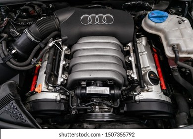 Novosibirsk, Russia – August 24, 2019: Audi A6, Close up detail of  car engine, front view. Internal combustion engine, car parts, deteyling