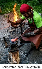 Novosibirsk, Russia - August 26, 2017. Beautiful view, background for reconstruction, horn, fire, anvil and hammer, forging cold arms to the blacksmith of the ancient people.