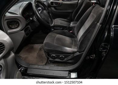 Novosibirsk, Russia – August 27, 2019:  Hyundai Santa Fe, Black car Interior - steering wheel, shift lever, multimedia  systeme, driver seats and dashboard