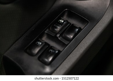 Novosibirsk, Russia – August 27, 2019:  Hyundai Santa Fe, Close up of a door control panel in a new modern car. Arm rest with window control panel, door lock button, and mirror control.