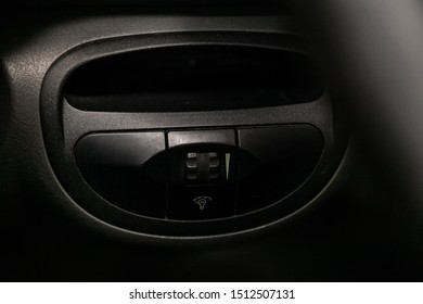 Novosibirsk, Russia – August 27, 2019:  Hyundai Santa Fe, Close-up on the headlight switch control buttons,  automatic adjust level dashboard. modern car interior: parts, buttons, knobs