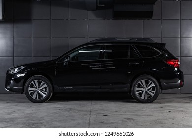 Novosibirsk, Russia - December 04, 2018: black Subaru Outback, side view. Photography of a modern car on a parking in Novosibirsk