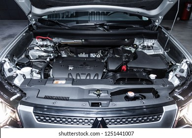 Novosibirsk, Russia - December 04, 2018:   Mitsubishi Outlander, close-up of the engine, front view. Photography of a modern car on a parking in Novosibirsk