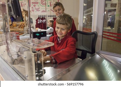 NOVOSIBIRSK, RUSSIA - DECEMBER 12: Opening of the children's city of professions. Kids try themselves in the role of cashier in supermarket on December 12, 2016 in Novosibirsk, Russia.