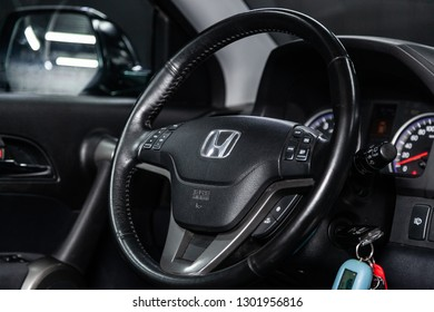Novosibirsk, Russia -  February 01, 2019:  Honda CR-V,  close-up of the dashboard, speedometer and tachometer and steering wheel. Photography of a modern car on a parking in Novosibirsk