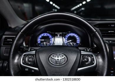 Novosibirsk, Russia -February  01, 2019:  Toyota Camry,  close-up of the dashboard, speedometer and tachometer and steering wheel. Photography of a modern car on a parking in Novosibirsk