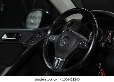 Novosibirsk, Russia - February 05, 2019: Volkswagen Tiguan, close-up of the dashboard, speedometer and tachometer and steering wheel. Photography of a modern car on a parking in Novosibirsk