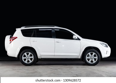 Novosibirsk, Russia - February 08, 2019:  Toyota RAV-4, side view. Photography of a modern car  on a parking in Novosibirsk against a black wall