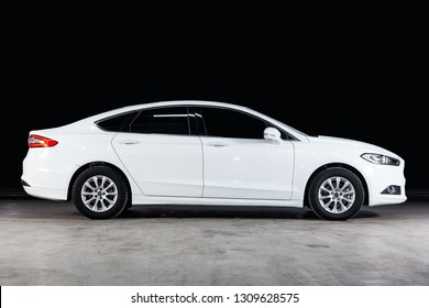 Novosibirsk, Russia - February 08, 2019:  Ford Mondeo, side view. Photography of a modern car  on a parking in Novosibirsk against a black wall