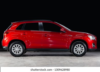 Novosibirsk, Russia - February 08, 2019:  Mitsubishi ASX, side view. Photography of a modern car  on a parking in Novosibirsk against a black wall