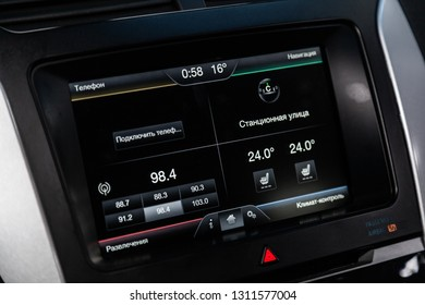 Novosibirsk, Russia - February 10, 2019:  Ford Explorer, close-up of the dashboard, monitor, player and navigator. Photography of a modern car on a parking in Novosibirsk