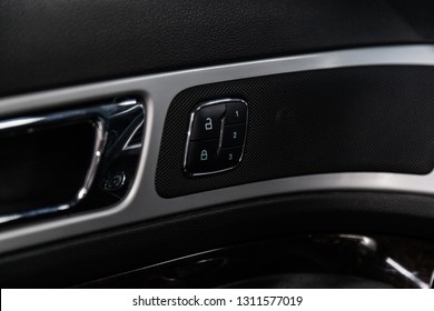 Novosibirsk, Russia - February 10, 2019:  Ford Explorer, close-up of the side door lock buttons door. Photography of a modern car on a parking in Novosibirsk