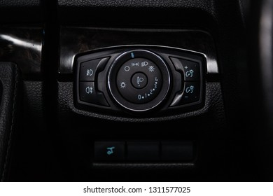Novosibirsk, Russia - February 10, 2019:  Ford Explorer, close-up of the headlight adjustment buttons. Photography of a modern car on a parking in Novosibirsk