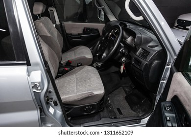 Novosibirsk, Russia - February 10, 2019:  Mitsubishi Pajero IO, close-up of the dashboard, speedometer, tachometer,seats and steering wheel. Photography of a modern car on a parking in Novosibirsk