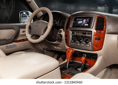 Novosibirsk, Russia - February 10, 2019:  Toyota Land Cruiser 100,close-up of the dashboard, speedometer, tachometer, seats and steering wheel. Photography of a modern car on a parking in Novosibirsk