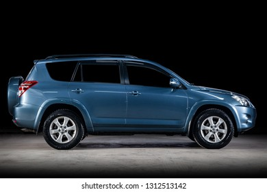 Novosibirsk, Russia - February 10, 2019:  Toyota RAV-4, side view. Photography of a modern car  on a parking in Novosibirsk against a black wall