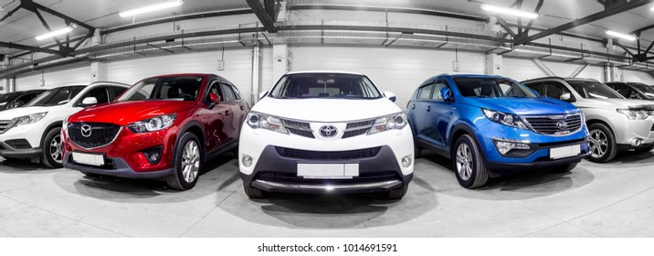 Novosibirsk, Russia - February 12, 2017:  in the car showroom are rows of city crossovers for sale: Mitsubishi, KIA, Mazda, Toyota and others