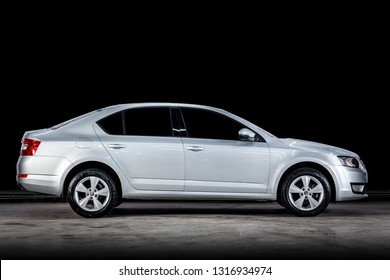 Novosibirsk, Russia - February 14, 2019:  Skoda Octavia, side view. Photography of a modern car  on a parking in Novosibirsk against a black wall