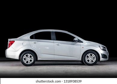 Novosibirsk, Russia - February 19, 2019:  Chevrolet Aveo, side view. Photography of a modern car  on a parking in Novosibirsk against a black wall