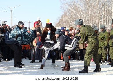 NOVOSIBIRSK, RUSSIA - FEBRUARY, 22: Young people compete in push-up exercise. Shrovetide celebration in Novosibirsk. Taken on February 22, 2015 in Novosibirsk, Russia.