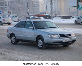 Novosibirsk, Russia - fubruary 5 2021: private silver gray color old luxury vintage germany sedan Audi A6 ( 4A, C4 ), car from 90s on the winter street