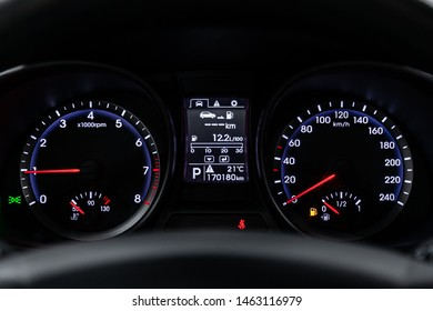 Novosibirsk, Russia – July 08, 2019:  Hyundai Santa Fe, close-up of the dashboard, speedometer and tachometer with white  and blue backlight. modern car interior