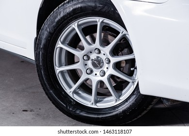 Novosibirsk, Russia – July 08, 2019:  Toyota Camry, close-up of the alloy wheel. Photography of a modern car on a parking in Novosibirsk