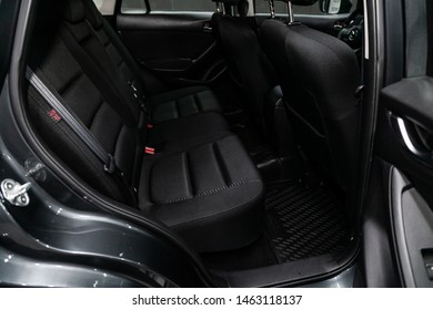 Novosibirsk, Russia – July 08, 2019:   Mazda CX-5, close-up of the black  rear seats with seats belt. modern car interior