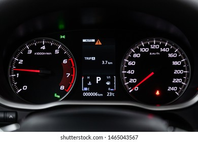 Novosibirsk, Russia – July 09, 2019: Mitsubishi Eclipse Cross, close-up of the dashboard, speedometer and tachometer with white backlight. modern car interior