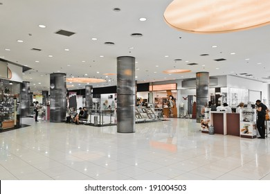 NOVOSIBIRSK, RUSSIA: JULY 11, 2013 - Interior of modern mall with some people in it