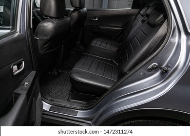 Novosibirsk, Russia – July 17, 2019:  SsangYong Actyon, close-up of the black  rear seats with seats belt. modern car interior