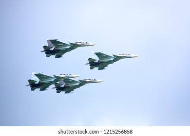 """Novosibirsk, Russia, July 31, 2016, Mochishche airfield, local air show, Aerobatic team VKS """"Russian Falcons"""" Su-30 SM, four russian fighter aircrafts in the cloudy sky"""