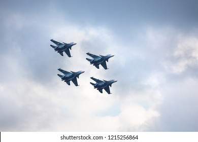 """Novosibirsk, Russia, July 31, 2016, Mochishche airfield, local air show, Aerobatic team VKS """"Russian Falcons"""" Su-30 SM, four russian fighter aircrafts in the blue coudy sky"""