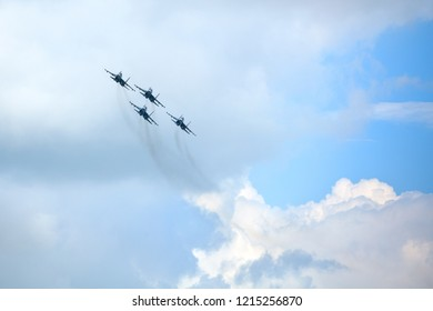 """Novosibirsk, Russia, July 31, 2016, Mochishche airfield, local air show, Aerobatic team VKS """"Russian Falcons"""" Su-30 SM, four russian fighter aircrafts in the sky"""