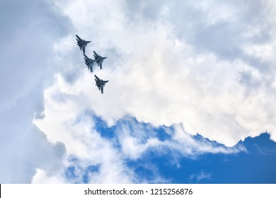 """Novosibirsk, Russia, July 31, 2016, Mochishche airfield, local air show, Aerobatic team VKS """"Russian Falcons"""" Su-30 SM, four russian fighter aircrafts in the blue sky with clouds"""