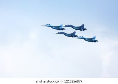 """Novosibirsk, Russia, July 31, 2016, Mochishche airfield, local air show, Aerobatic team VKS """"Russian Falcons"""" Su-30 SM, russian fighter aircrafts in the blue sky"""