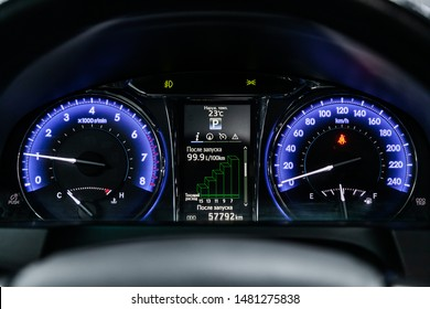 Novosibirsk, Russia – July 31, 2019:  Toyota Camry,Car dashboard with blue  backlight: Odometer, speedometer, tachometer, fuel level, water temperature and more